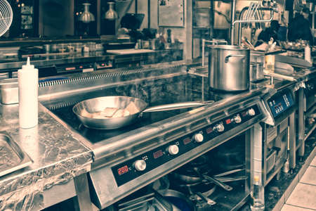 Professional kitchen interior, toned image Stock Photo