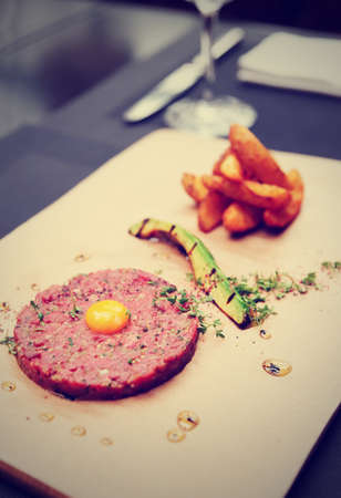 space age: Beef tartare on restaurant table, copy space, toned i,age
