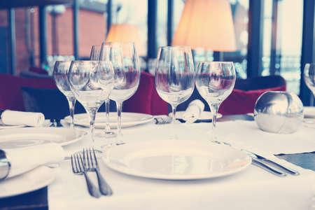 Place setting in a restaurant, toned image Stockfoto