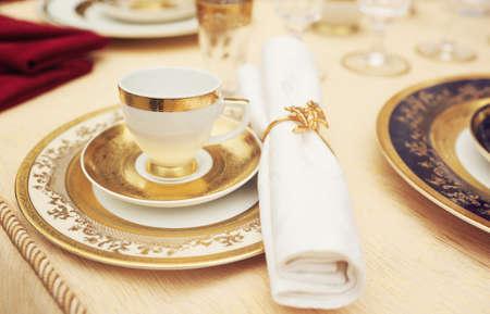 Set of fine bone porcelain dishware, shallow focus, toned image Stock Photo