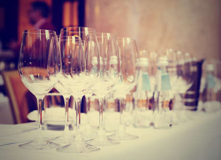 wine glasses: Wine glasses on a restaurant table