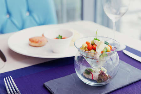 Cutlets, potato mash and vegetable salad on restaurant table - healthy food, toned image
