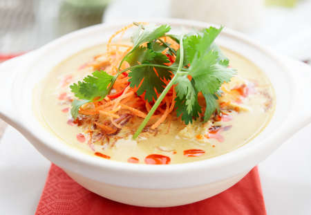 curry dish: Bowl of spicy curry dish Tom Yam, Thai cuisine