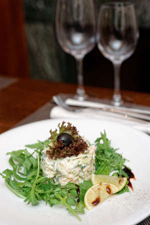 Seafood appetizer with rocket salad on restaurant table