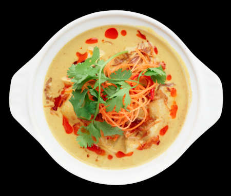 curry dish: Bowl of  Tom Yam, spicy curry dish, shot from above isolated on black background with clipping path