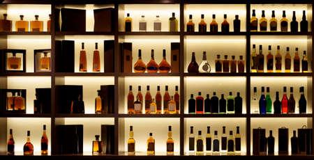 Various alcohol bottles in a bar, back light, all logos removed Stok Fotoğraf - 71881536