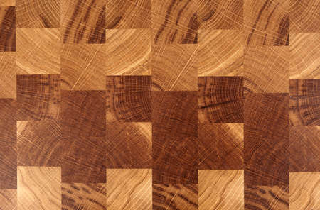 crosscut: Wooden cutting board, cross cut chess board-like texture Stock Photo