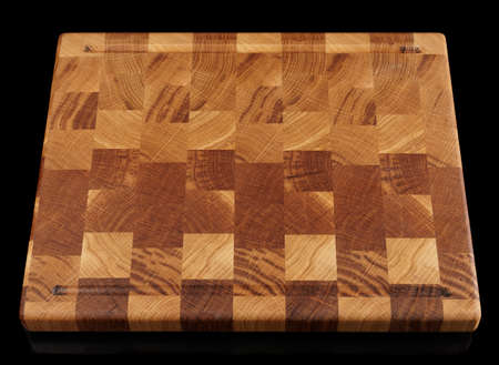 crosscut: Wooden cutting board isolated on black background