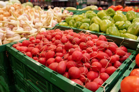 Red radish and another vegetables in supermarket or grocery store Stock Photo