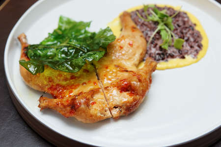 Fried chicken with sweet-suor sauce and risotto on plate Stock Photo