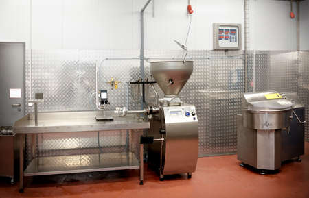 Sausage stuffing machine not in operation on food processing plant, toned image