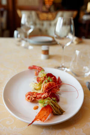 Sicillian shrimp appetizer on restaurant table, gourmet dish