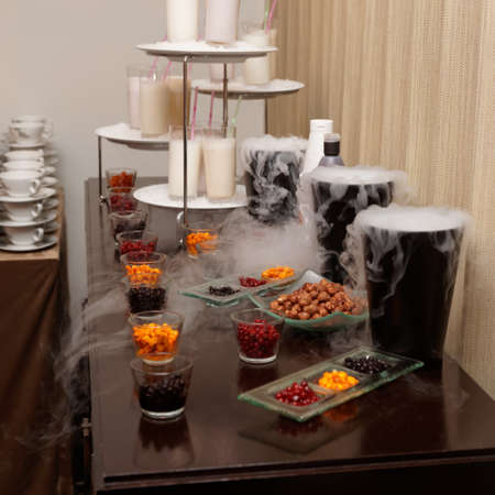 Choice of berry mixers and milkshakes on catering table in hotel