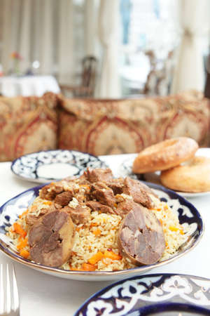 Middle Eastern pilaf rice in plate on restaurant table