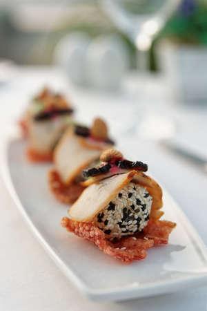 Smoked fish, sesame cheese ball and tapioca chips - creative banquet dish