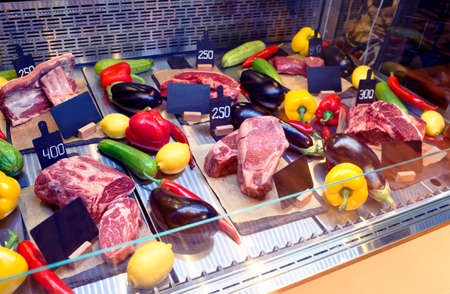 Meat display in butcher shop or steak house restaurant, toned image Фото со стока