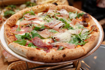 Neapolitan style pizza with prosciutto ham and grated parmesan