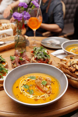 Pumpkin soup and another food on table, Italian food