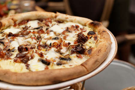 Pizza with potato mash, mushrooms and fried bacon, creative style