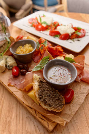 Meat, cheese and another starters on wooden board, Italian food 版權商用圖片