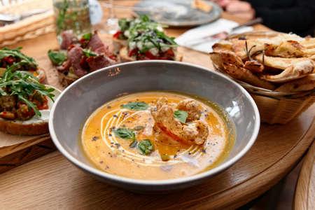 Pumpkin soup on restaurant table, Italian food