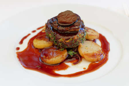 Beef steak with foie gras and truffles, close-up