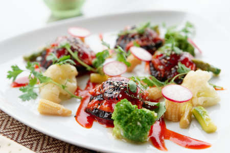 Asian and Western fusion style vegetable appetizer on plate - eggplant stuffed with shrimps