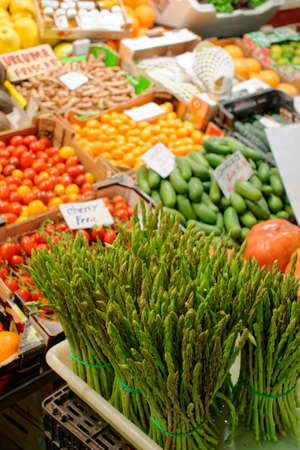Fresh asparagus and another vegetables on food market display