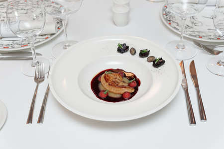 Foie gras dish on restaurant table, formal dining setting