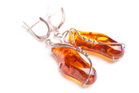 Amber earrings, close-up, isolated on white background