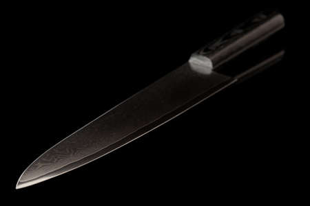 New chef knife isolated on black background