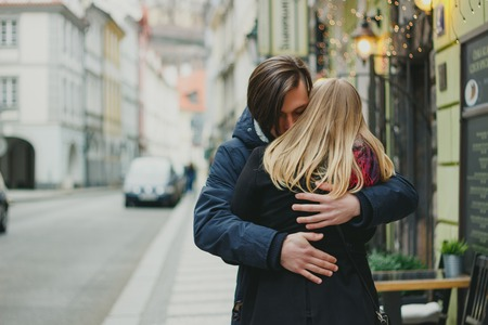 Romantic young couple in love, hugging on the street.