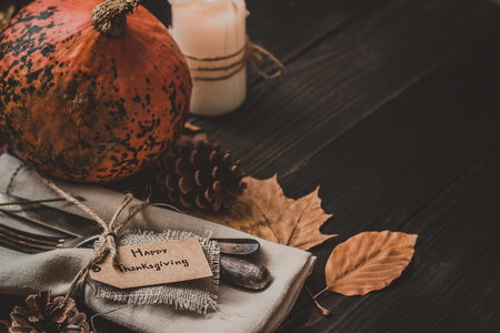 Thanksgiving decoration with cutlery and napkin on the wooden table, close up. Selective focus. Archivio Fotografico