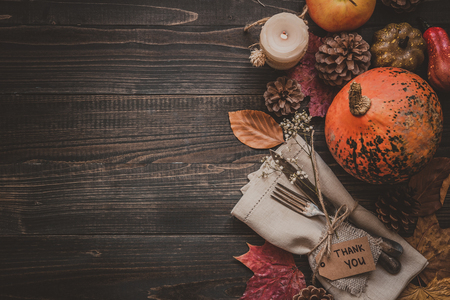 Thanksgiving decoration with cutlery and napkin on the wooden table, top view. Copy space. Archivio Fotografico