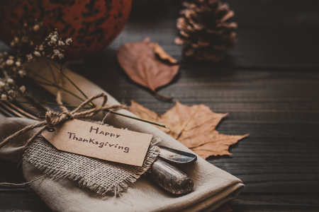 Thanksgiving decoration with cutlery and napkin on the wooden table, close up. Selective focus. 스톡 콘텐츠