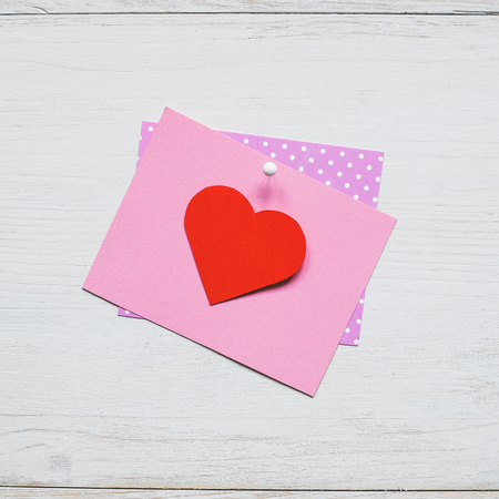 Valentines day background. Valentine card with heart on the wooden background.