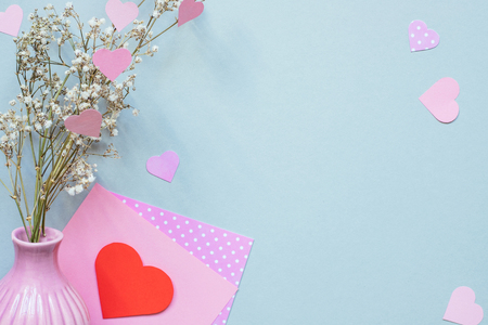 Valentines day background. Valentine card with heart and flowers on the blue background. Copy space.