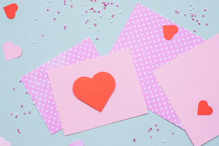 Valentines day background. Valentine card with heart and craft paper on the blue background. Фото со стока