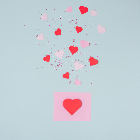 Valentines day background. Valentine card with paper hearts on the blue background. Фото со стока