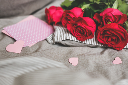 Romantic background with copy space. Beautiful roses and card with heart. Selective focus. Фото со стока
