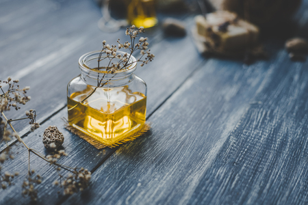 Spa composition. Aroma essential oil on rustic wooden background, selective focus. 스톡 콘텐츠