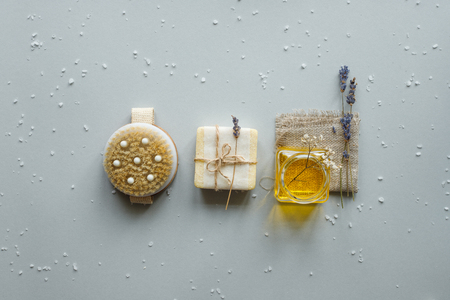 Spa composition. Various products for spa treatments on rustic wooden background.
