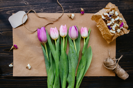 Bouquet of beautiful fresh tulips with decoration on the wooden background. 版權商用圖片