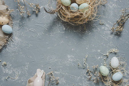 Easter composition. Easter eggs with easter decoration, top view. Copy space.