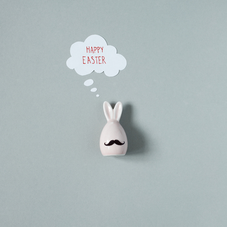 Happy Easter. Funny easter bunny with mustache on gray background. 版權商用圖片