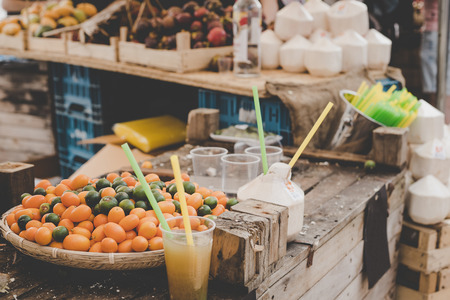 Ripe kumquats with fresh juice from kumquats at street food market.