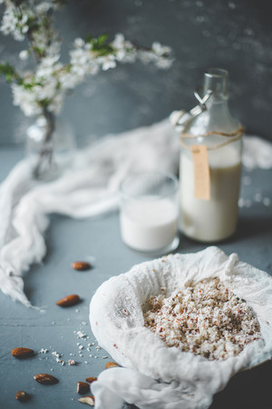 Almond pulp from vegan almond milk on wooden background. Selective focus. Stock Photo