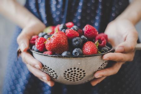 Organic fresh berries. Hands holding fresh juicy berries, closeup