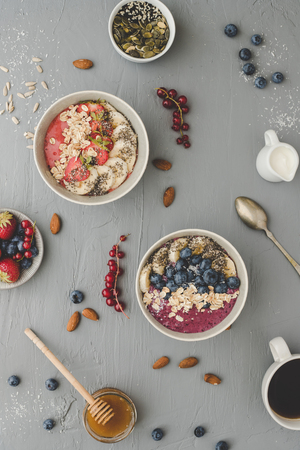 Helthy breakfast. Delicious smoothie bowls with fruits, berries and seeds.