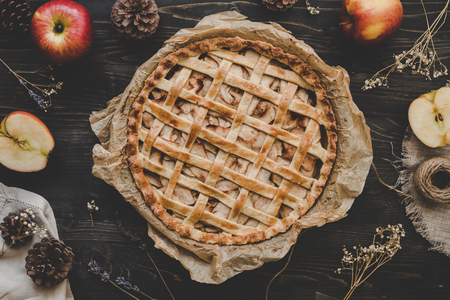 Traditional homemade apple pie on the wooden table. Top view Stock Photo